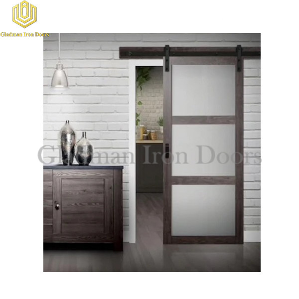 Wrought Iron Barn Door With Exposed Tracks